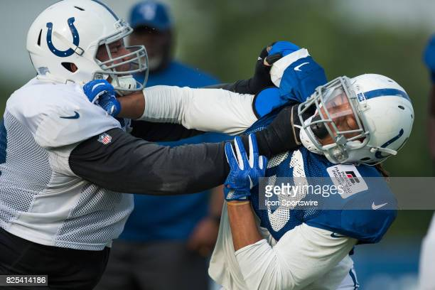 Indianapolis Colts outside linebacker Jabaal Sheard and Indianapolis Colts tackle Zach Banner run through a drill during the Indianapolis Colts...