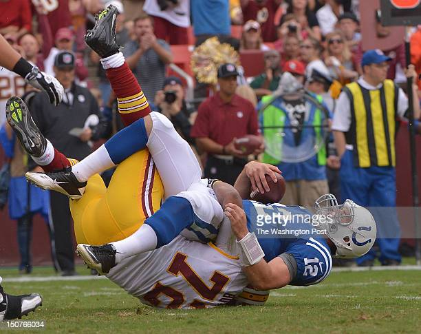 Indianapolis Colts quarterback Andrew Luck is sacked by Washington Redskins defensive end Stephen Bowen during the first quarter at FedEx Field on...