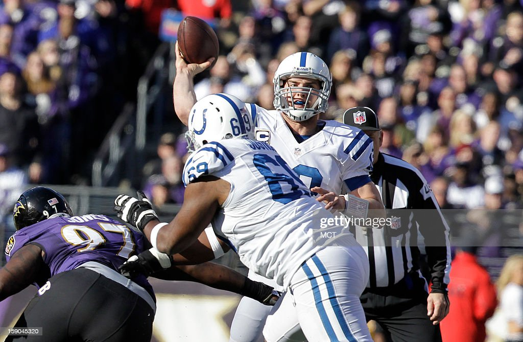 Indianapolis Colts quarterback Andrew Luck (12) passes the ball as Colts tackle Winston Justice (69) blocks Baltimore Ravens defensive end Arthur Jones (97) during the first half of an AFC playoff game against the Baltimore Ravens in Baltimore, Maryland, on Sunday, January 6, 2013. The Ravens won 24-9.