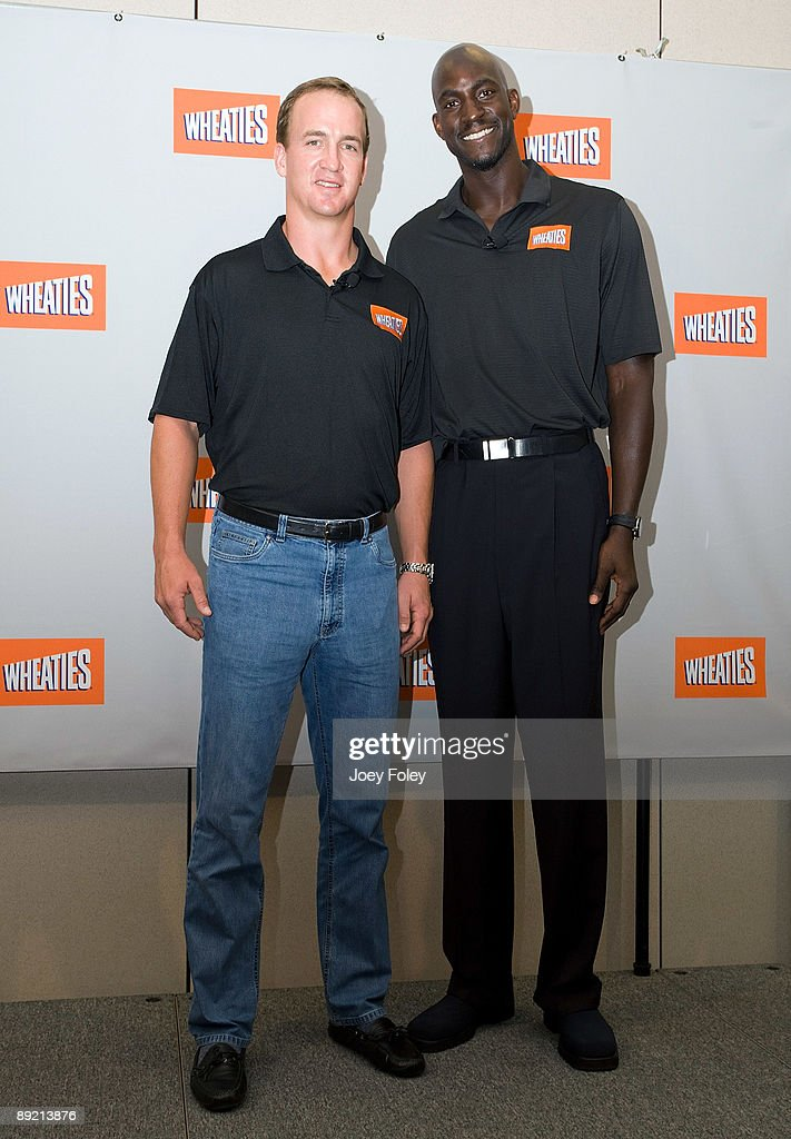 Indianapolis Colts quarterback Peyton Manning and NBA Basketball star Kevin Garnett pose for a photograph after a press conference at Conseco Fieldhouse on July 23, 2009 in Indianapolis, Indiana.