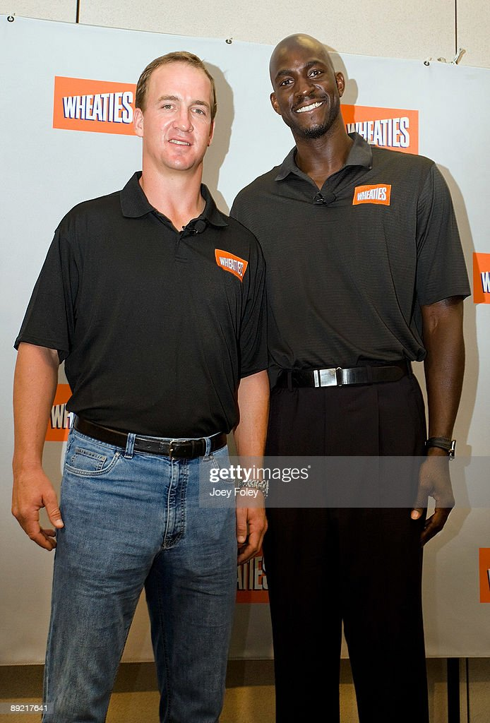 Indianapolis Colts quarterback <a gi-track='captionPersonalityLinkClicked' href=/galleries/search?phrase=Peyton+Manning&family=editorial&specificpeople=184524 ng-click='$event.stopPropagation()'>Peyton Manning</a> and NBA star Kevin Garnett pose for a photograph after a press conference at Conseco Fieldhouse on July 23, 2009 in Indianapolis, Indiana.