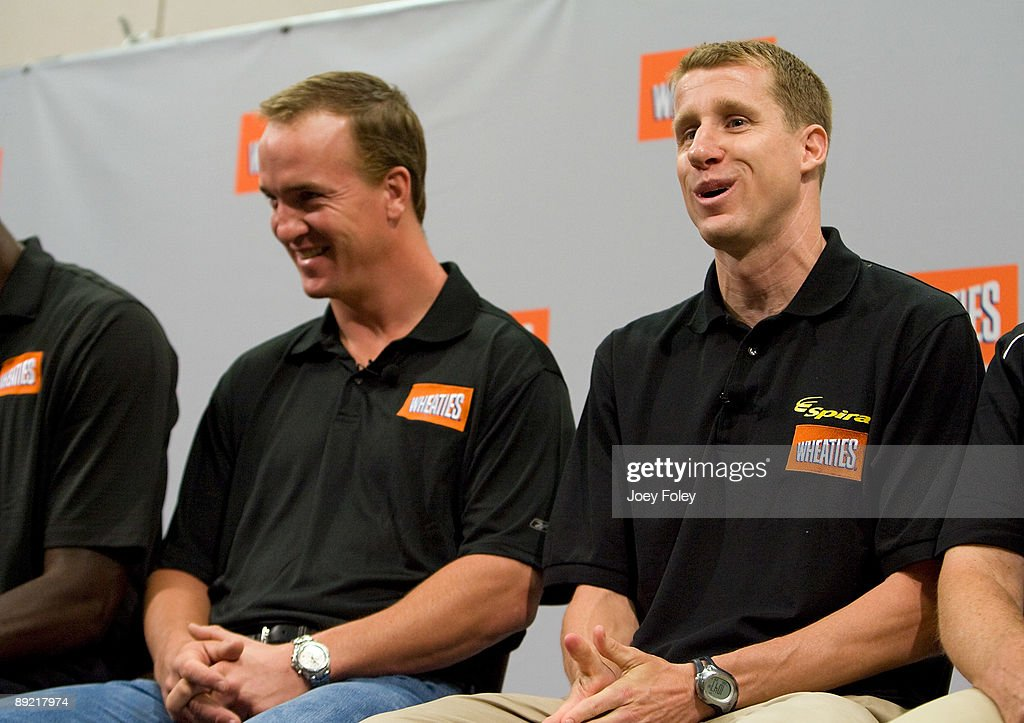 Indianapolis Colts quarterback Peyton Manning and triathlete Hunter Kemper talk about the process of creating a new Wheaties breakfast cereal during a press conference at Conseco Fieldhouse on July 23, 2009 in Indianapolis, Indiana.