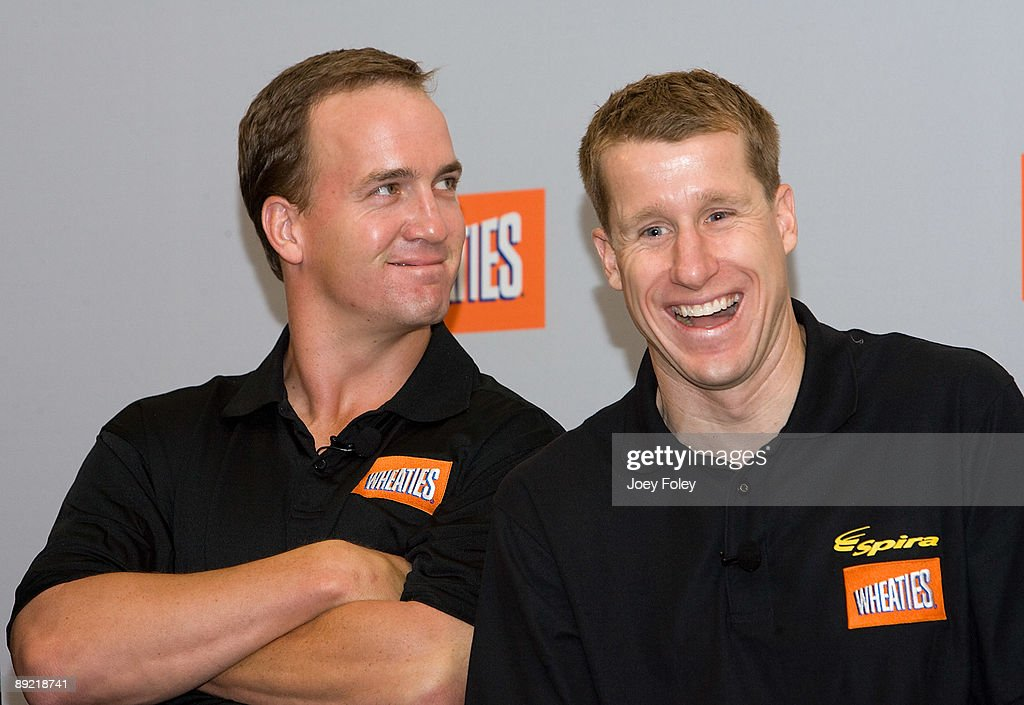Indianapolis Colts quarterback Peyton Manning and triathlete Hunter Kemper laugh as they watch a promotional video of a new version of Wheaties during a press conference at Conseco Fieldhouse on July 23, 2009 in Indianapolis, Indiana.