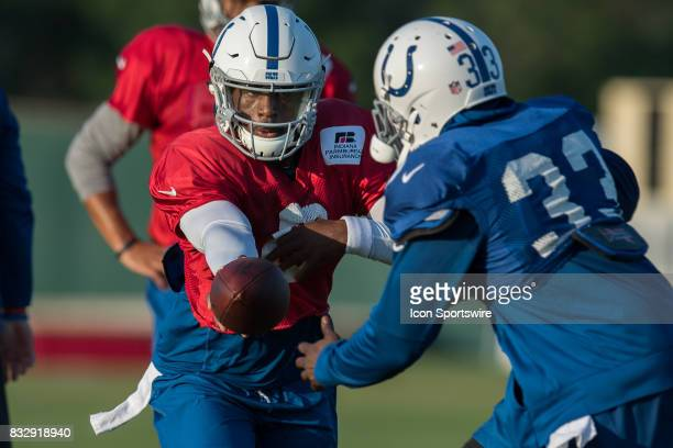 Indianapolis Colts quarterback Phillip Walker hands off to Indianapolis Colts running back Robert Turbin during the Indianapolis Colts training camp...