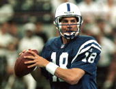 Indianapolis Colts rookie quarterback Peyton Manning looks for a received during a preseason game with the San Diego Chargers 22 August at the RCA...