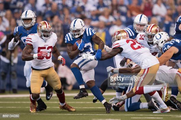 Indianapolis Colts running back Frank Gore moves into 7th place on the alltime rushing list on this run during the NFL game between the San Francisco...