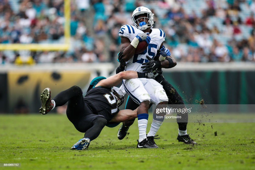 Indianapolis Colts running back Marlon Mack (25) is tackled by Jacksonville Jaguars linebacker Paul Posluszny (51) during the game between the Indianapolis Colts and the Jacksonville Jaguars on December 3, 2017 at EverBank Field in Jacksonville, Fl.