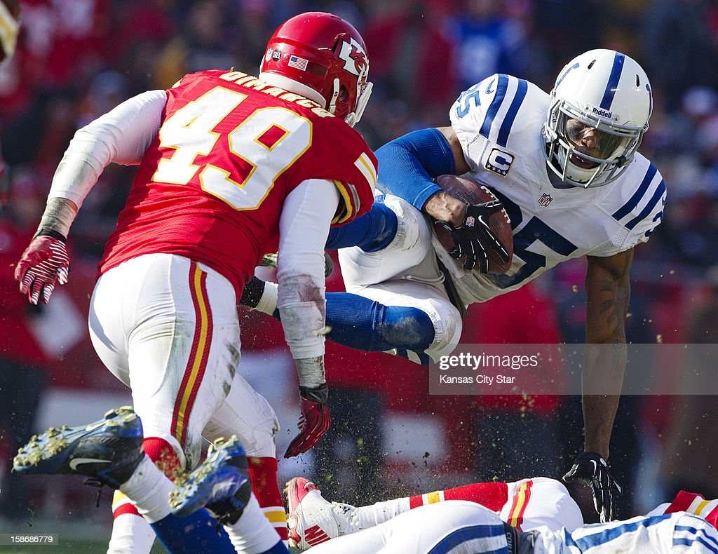 Indianapolis Colts strong safety Joe Lefeged (35) is tripped up after recovering a fumble by Kansas City Chiefs running back Jamaal Charles in the second quarter at Arrowhead Stadium on Sunday, December 23, 2012, in Kansas City, Missouri. The Indianapolis Colts defeated the Kansas City Chiefs, 20-13.