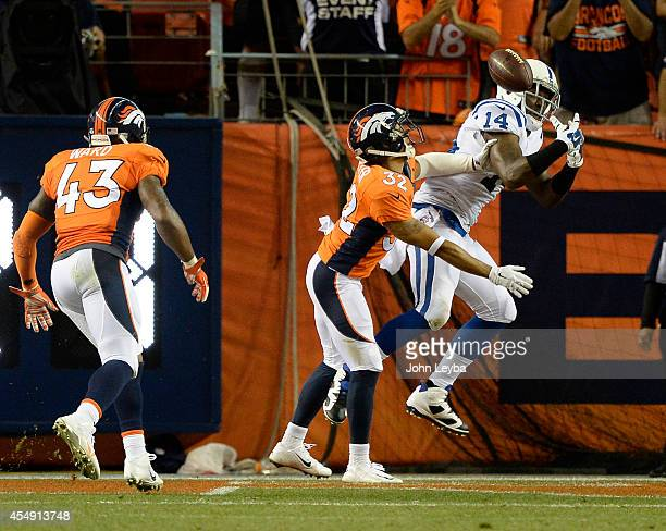 Indianapolis Colts wide receiver Hakeem Nicks hauls down a touchdown catch in the back of the end zone as Denver Broncos cornerback Tony Carter deeds...