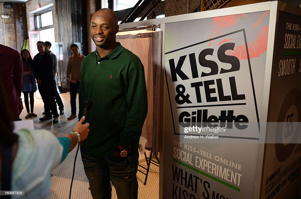 Indianapolis Colts wide receiver Reggie Wayne attends Gillette's Kiss & Tell Live National Experiment and gets the sparks flying by asking women which kiss is best: a kiss with a stubble or smooth shaven skin on February 2, 2013 in New Orleans, Louisiana.