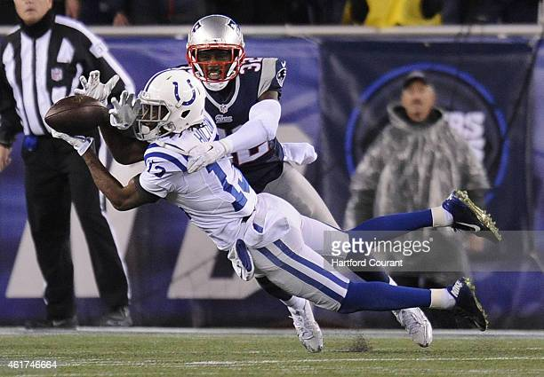 Indianapolis Colts wide receiver TY Hilton and New England Patriots free safety Devin McCourty battle for the ball during the first half on Sunday...