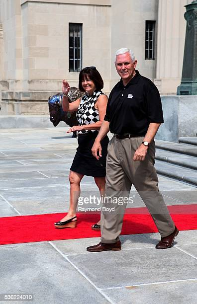 Indianapolis Governor Mike Pence and his wife Karen greets the media outside the Indianapolis Central Library during the Indianapolis 500 Festival...