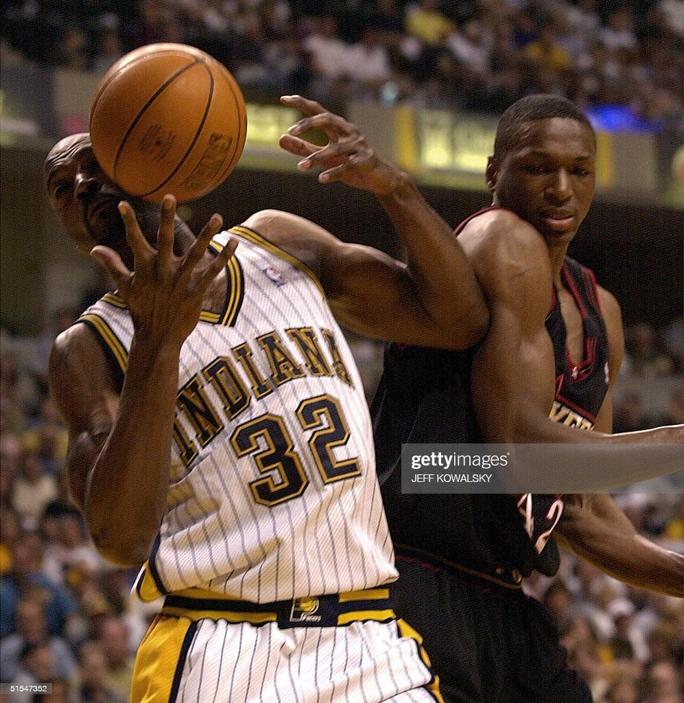 Indianapolis Pacers Dale Davis grabs a rebound be