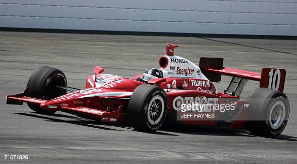 2005 Indy 500 winner Dan Wheldon of England takes the first turn during the 90th Indianapolis 500 at the Indianapolis Motor Speedway 28 May 2006 in...