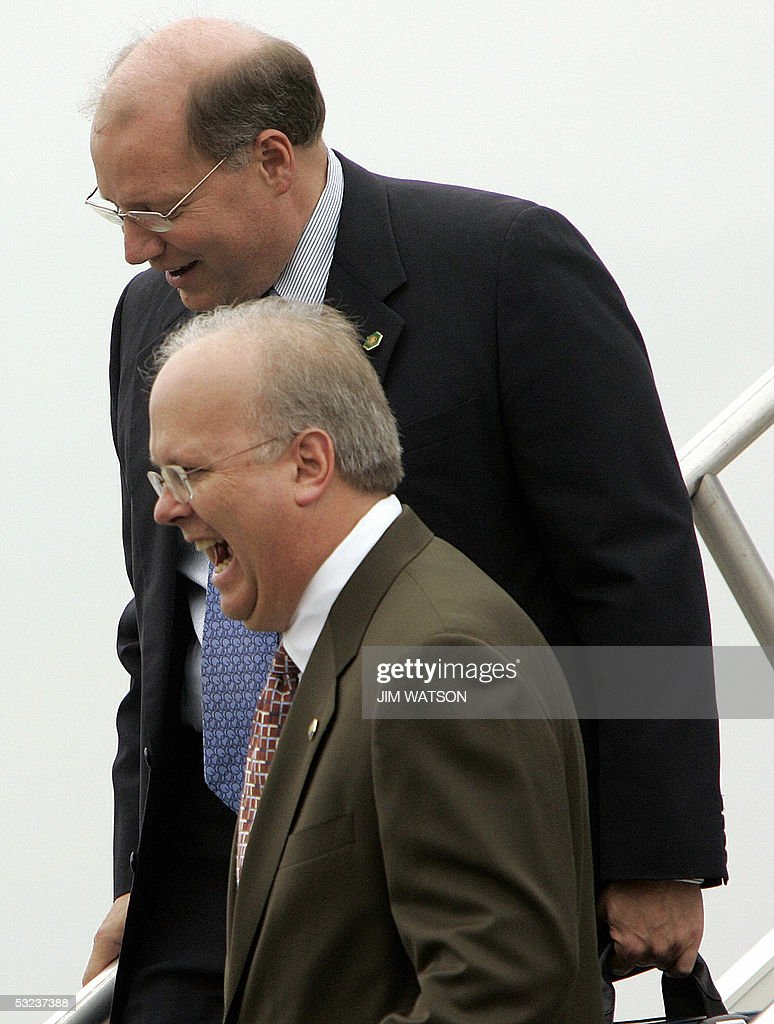 Top White House Advisor Karl Rove has a laugh with Deputy White House Chief of Staff Joe Hagin as they walk off Air Force One in Indianapolis Indiana...
