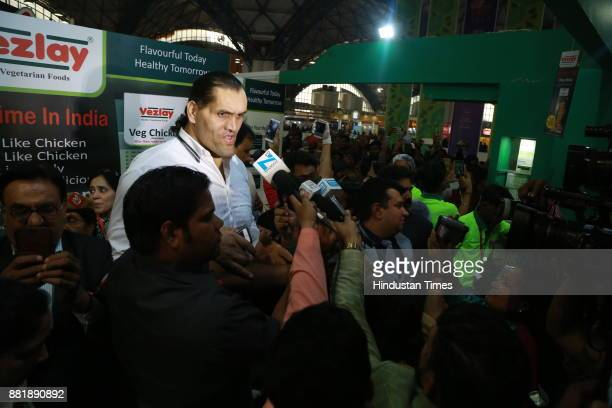 Indianborn American wrestler The Great Khali surrounded by fans during visit to the trade fair at Pragati Maidan for promotional activity at the fair...
