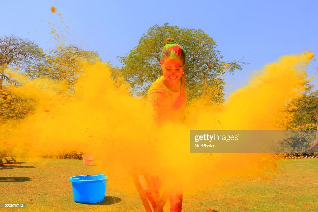 Indians and Foreigners tourist celebrating Holi Festival at City Palace in Jaipur, Rajasthan , India on 13 March , 2017.