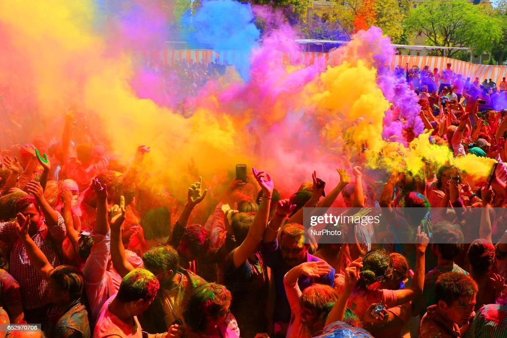 Indians and Foreigners tourist celebrating Holi Festival at Khasa Kothi organised by Rajasthan Tourism in Jaipur, Rajasthan , India on 13 March , 2017.