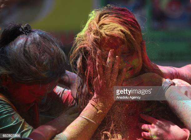 Indians attend the Holi Festival celebrations in Mumbai India on March 13 2017 Holi the festival of colors is a riotous Hindu celebration of the...
