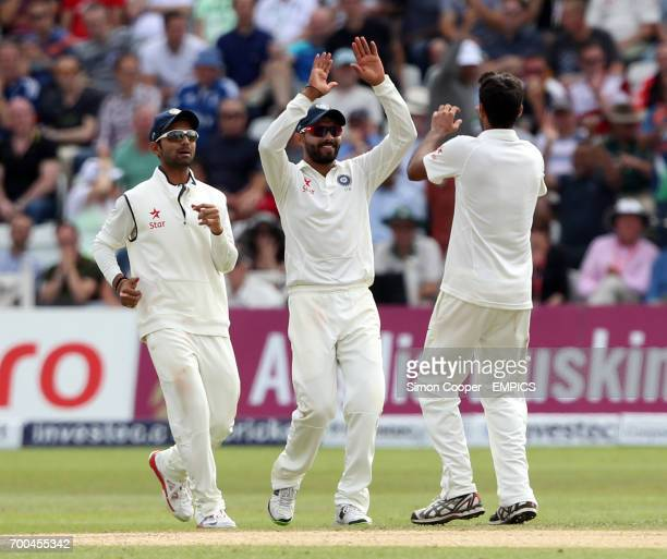 Indians' Bhuvneshwar Kumar celebrates with teammates after taking the wicket of England's Ben Stokes