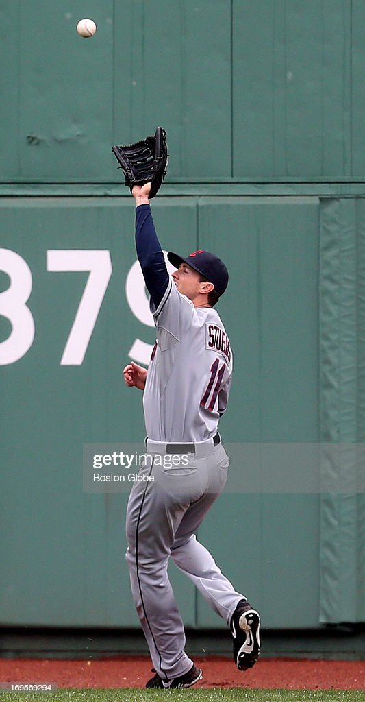 Indians center fielder Drew Stubbs makes an out as the Boston Red Sox play the Cleveland Indians at Fenway Park.