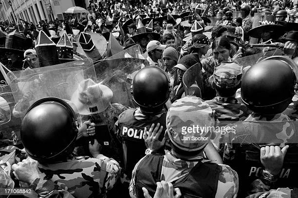 Indians clash with the riot police block during the Inti Raymi festivities in Cotacachi Ecuador 29 June 2010 La toma de la Plaza is an ancient ritual...