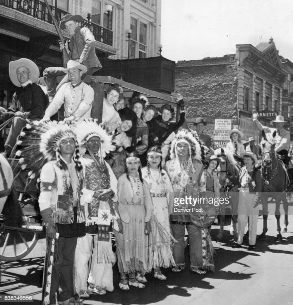 """Indians Cowboys and a Stagecoach the last loaded with 'pioneer gals"""" invaded Denver to invite Gov Lee Knous and Mayor Quigg Newton to Idaho Springs'..."""