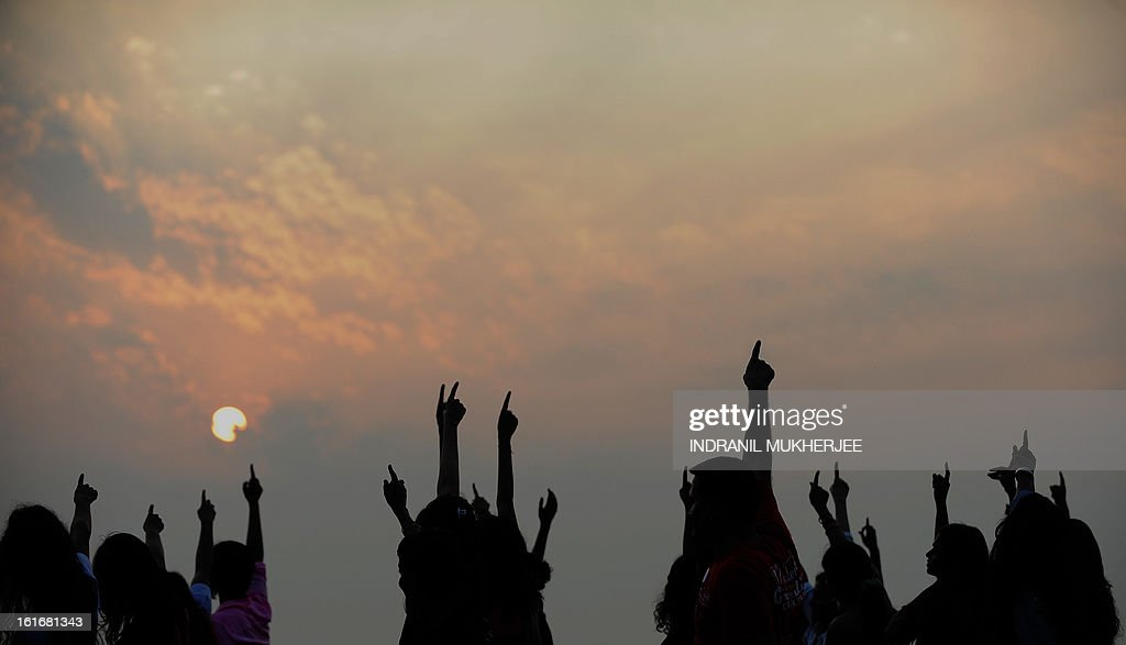 Indians dance as they participate in a 'One Billion Rising' rally in Mumbai on February 14, 2013. Indians were at the forefront of global protests on Thursday in the One Billion Rising campaign for women's rights, galvanised by the recent fatal gangrape that shocked the country. AFP PHOTO/Indranil MUKHERJEE