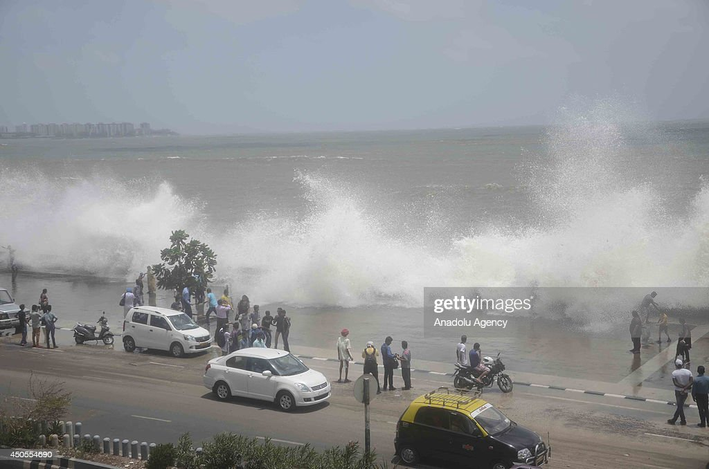 Indians enjoy high tide waves on the Arabian Sea coast in Mumbai India on June 13 2014 According to local reports the city would witness high tides...