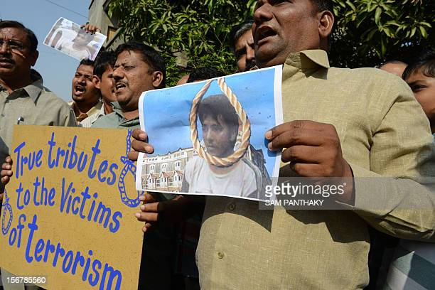 Indians hold up placards as they celebrate the execution of Pakistanborn Mohammed Kasab who was the sole surviving gunman of the 2008 Mumbai attacks...