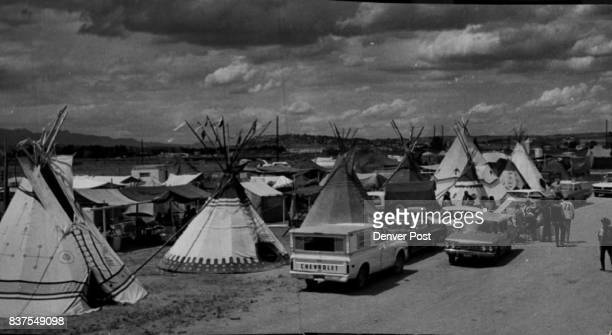 Indians in Camp Teepees share space with cars and campers at the American Indian Centennial Encampment at Skaggs Rodeo Arena in Colorado Springs...
