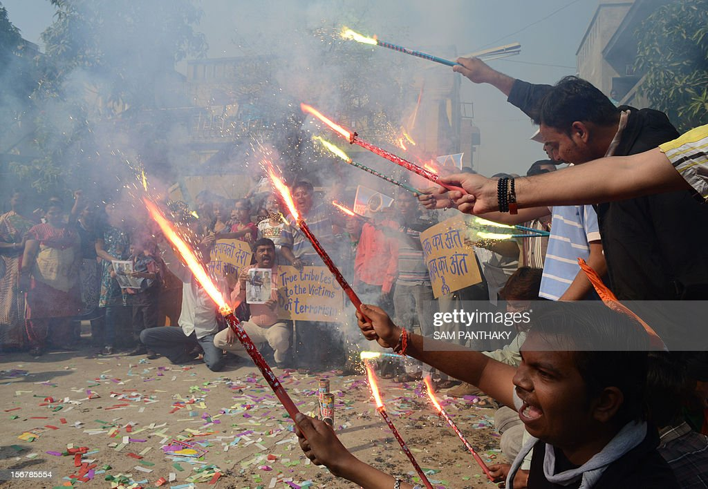 Indians light fireworks as they celebrate the execution of Pakistanborn Mohammed Kasab who was the sole surviving gunman of the 2008 Mumbai attacks...