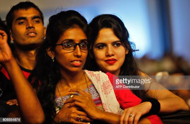 Indians listen to a speech given by Prime Minister Narendra Modi during a meeting with Indian community at the Tel Aviv Convention Center in the...