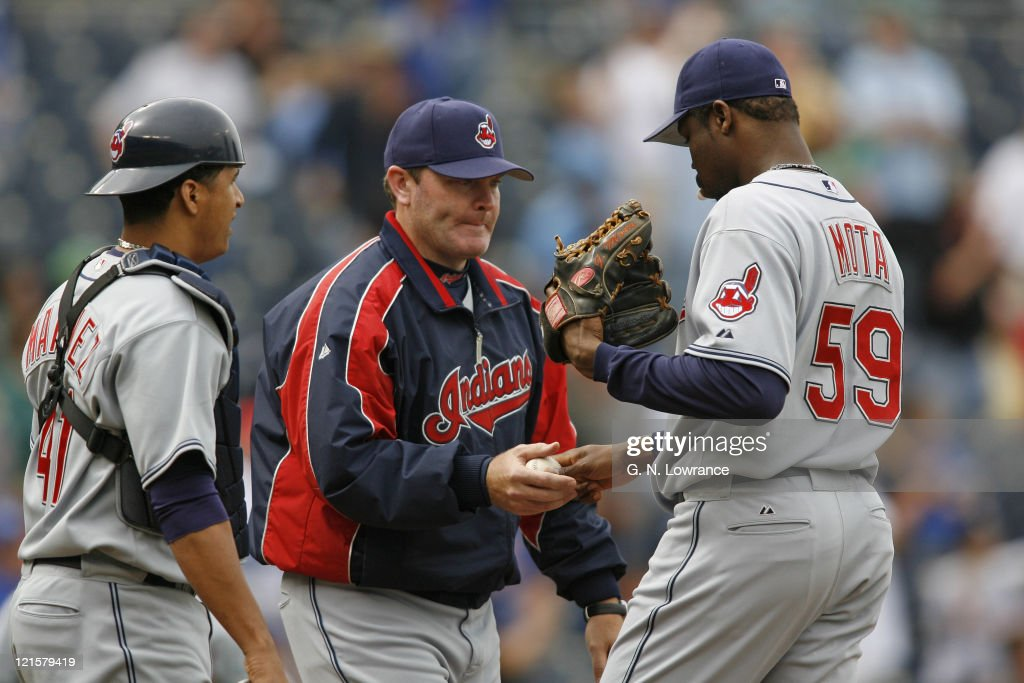 Indians manager <a gi-track='captionPersonalityLinkClicked' href=/galleries/search?phrase=Eric+Wedge&family=editorial&specificpeople=214257 ng-click='$event.stopPropagation()'>Eric Wedge</a> takes the ball from relief pitcher <a gi-track='captionPersonalityLinkClicked' href=/galleries/search?phrase=Guillermo+Mota&family=editorial&specificpeople=208080 ng-click='$event.stopPropagation()'>Guillermo Mota</a> during action between the Cleveland Indians and Kansas City Royals at Kauffman Stadium in Kansas City, Missouri on May 10, 2006. The Royals won 10-8 as they swept the Indians.
