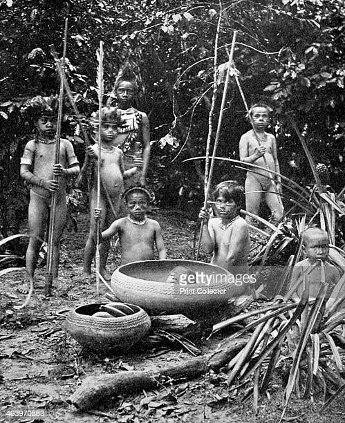 Indians of the Putumayo River with a decapitated head Amazonia Possibly members of the Shuar people who practised headhunting A print from Customs of...