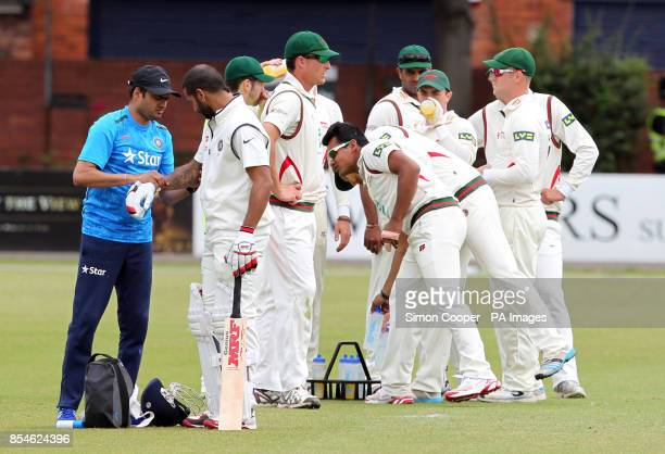 Indians' Shikhar Dhawan retires hurt after during day one of the international warm up match at Grace Road Leicester