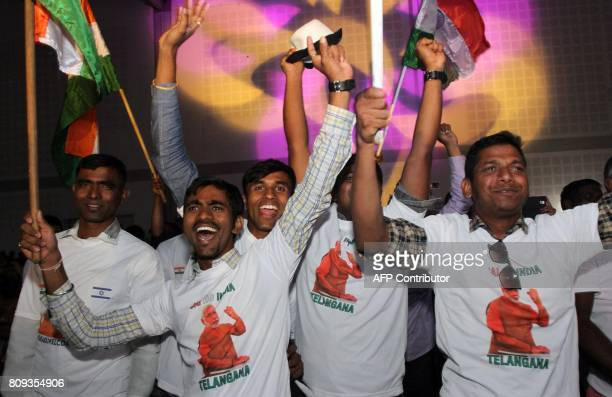 Indians wave national flags in celebration as they attend a speech given by Prime Minister Narendra Modi during a meeting with Indian community at...