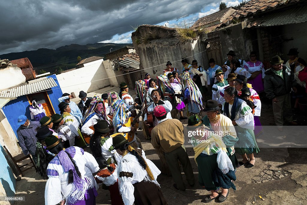 "Indians, wearing colorful costumes, dance in the circle during the Inti Raymi festival on 26 June 2010 in the village of Olmedo, Ecuador. Inti Raymi, ""Festival of the Sun"" in Quechua language, is an ancient spiritual ceremony held in the Indian regions of the Andes, mainly in Ecuador and Peru. The lively celebration, set by the winter solstice, goes on for various days. The highland Indians, wearing beautiful costumes, dance, drink and sing with no rest. Colorful processions in honor of the God Inti (Sun) pass through the mountain villages giving thanks for the harvest and expressing their deep relation to the Mother Earth (Pachamama)."