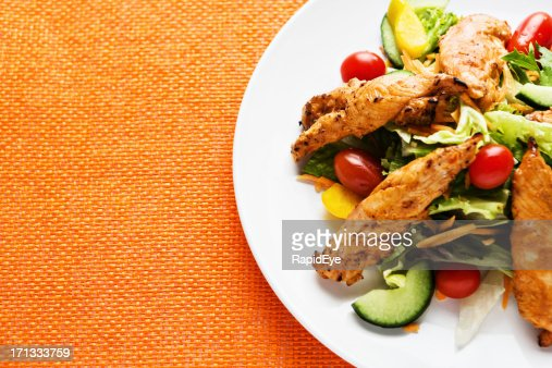 Indian-style spiced chicken salad on orange place mat