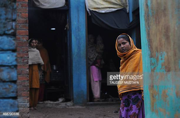 IndiaPakistanKashmirrefugees by Parvaiz BUKHARI In this photograph taken on March 2 Hindu refugee women from West Pakistan stand in the doorways of...