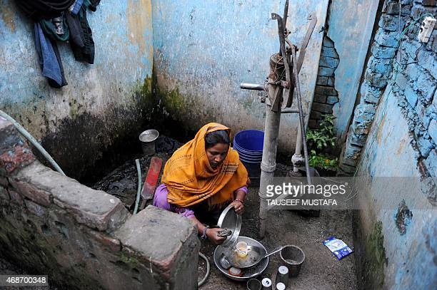 IndiaPakistanKashmirrefugees by Parvaiz BUKHARI In this photograph taken on March 2 a Hindu refugee from West Pakistan washes utensils at a communal...