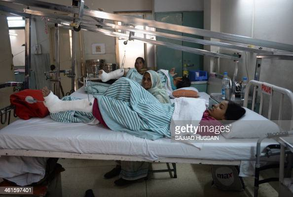 IndiapoliohealthFOCUS by Adam PLOWRIGHT In this picture taken on January 7 an Indian polio patient lies on a bed during treatment at St Stephens...