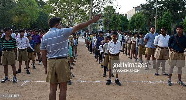 IndiapoliticsreligionRSSFOCUS by RACHEL O Indian swayamsevaks or volunteers from the Rashtriya Swayamsevak Sangh the country's biggest grassroots...