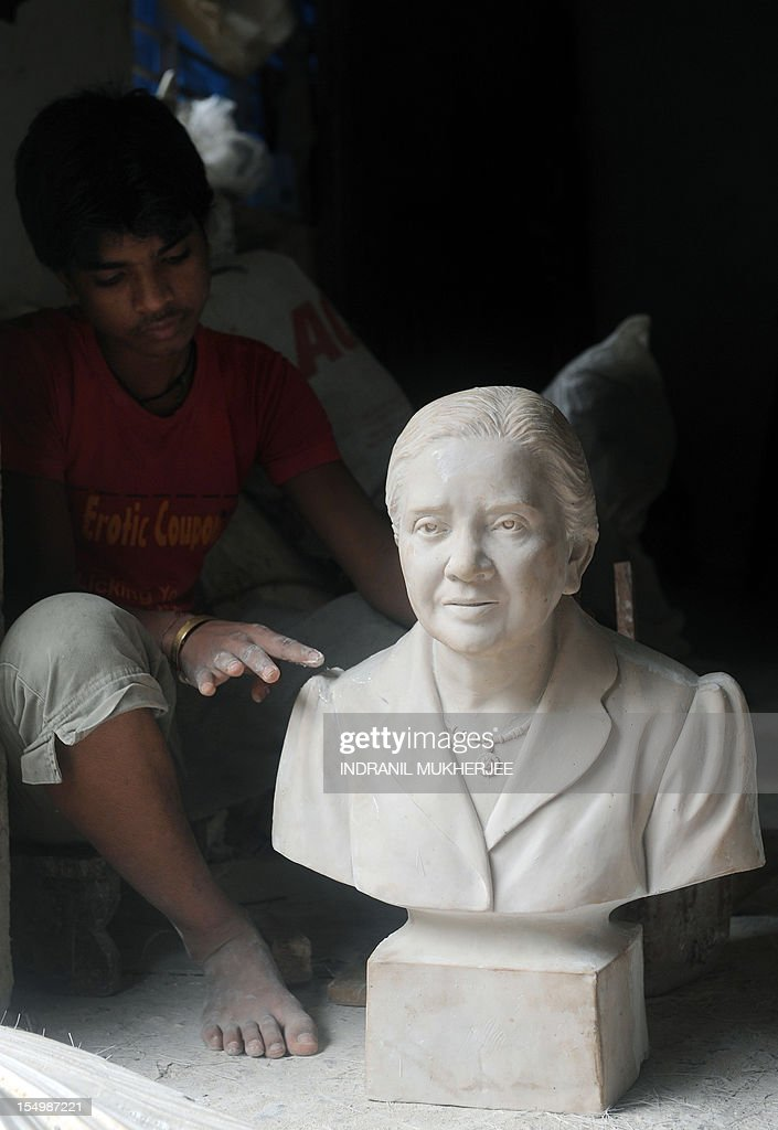 India-religion-society-art,FEATURE by Rachel O'Brien This photo taken on August 31, 2012 shows an Indian worker giving a coat of polish to a bust at the Sequeira brothers' home and workshop in Small Giriz, some 70 kms north of Mumbai. For when a photograph is not enough, the Sequeiras -- a third-generation family of religious effigy makers -- operate a successful sideline to bereaved relatives who want a three-dimensional tribute to their lost loved ones. Using old photographs to capture a likeness, the statues and busts are made of wood or fibreglass, coloured with paint and completed with realistic glass eyes.