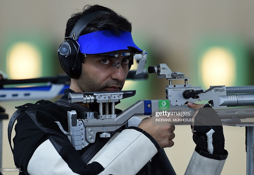 India's Abhinav Bindra concentrates during the men's 10m air rifle event at the Ongnyeon International shhoting range of the 2014 Asian Games in...