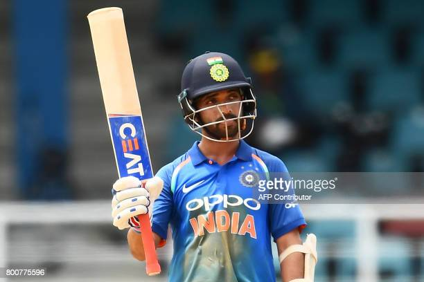 India's Ajinkya Rahane celebrates after scoring his century during the second One Day International match between West Indies and India at the...