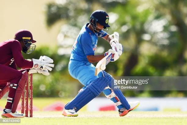 India's Ajinkya Rahane plays a shot as West Indies' wicketkeeper Shai Hope looks on during the fourth One Day International match between West Indies...