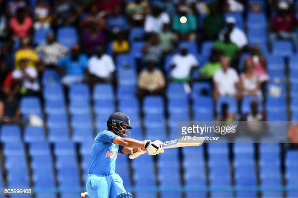 India's Ajinkya Rahane plays a shot during the fourth One Day International match between West Indies and India at the Sir Vivian Richards Cricket...
