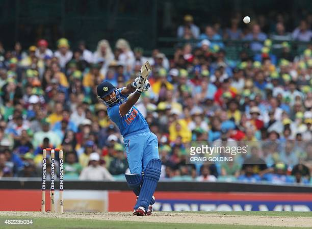 India's Ambati Rayudu hits a six during the one day international cricket match between Australia and India in Sydney on January 26 2015 AFP PHOTO /...