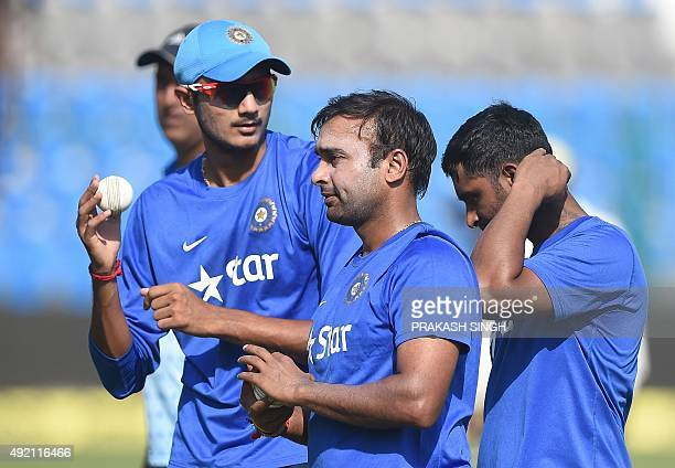 India's Amit Mishra Axar Patel and Ambati Rayudu wait for their turn to bowl in nets during a training session on the eve of the first one day...